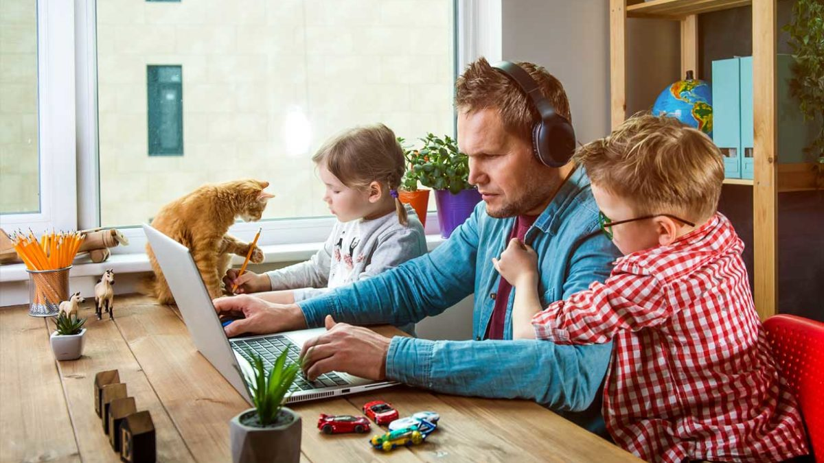 Article image of man working from home with children