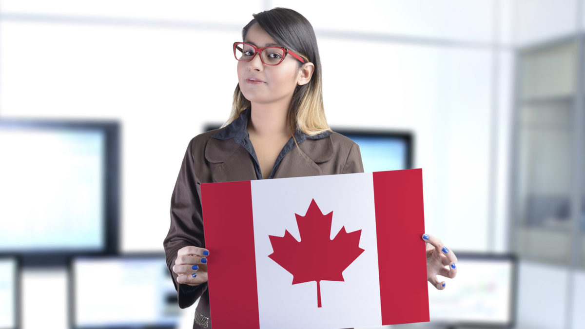 Article image of woman holding Canadian flag