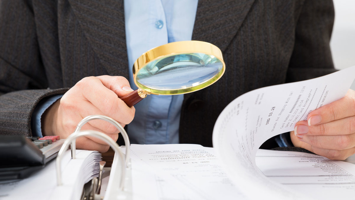 Article image of man using magnifying glass