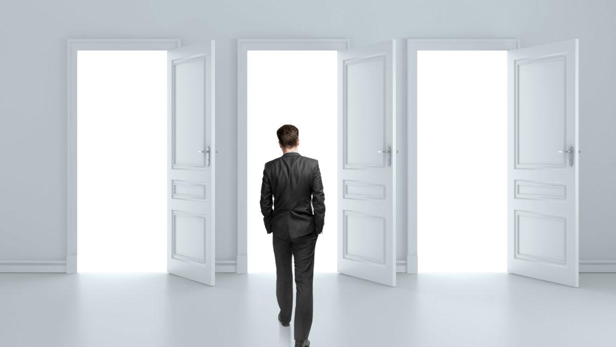 Article image of man walking through doors